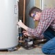 man working on water heater